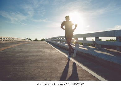 Athlete runner feet running on road