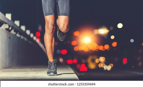 Athlete runner feet running on road, Jogging concept in the city