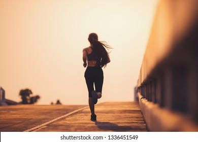 Athlete runner feet running on road, Jogging concept at outdoors. Woman running for exercise.