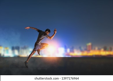 Athlete runner feet running on road, Jogging concept at outdoors. Man running for exercise on City background.