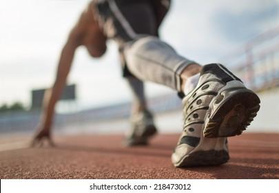 Athlete runner feet running on treadmill closeup on shoe.