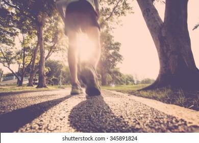 Athlete runner feet running on road