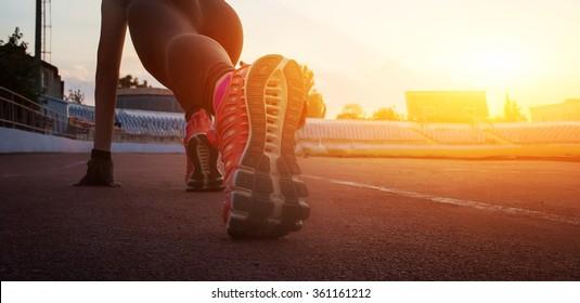 Athlete runner feet running on treadmill closeup on shoe