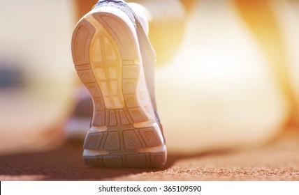 Athlete runner feet running on treadmill.closeup on shoe