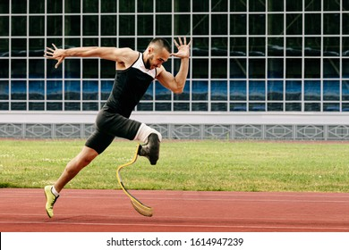 athlete runner physically disabled run on track of stadium