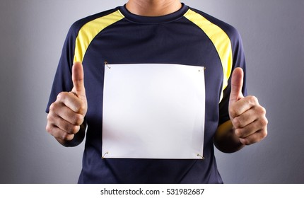 Athlete or runner pointing at blank race bib, symbolic victory, The wonderful symbolic.