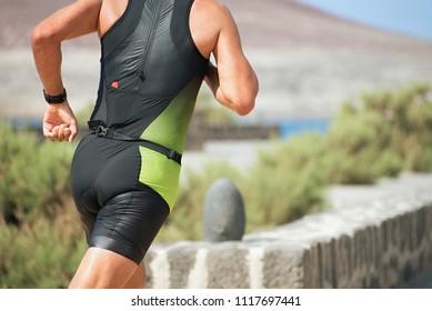 Athlete runner running on triathlon race on sunny days