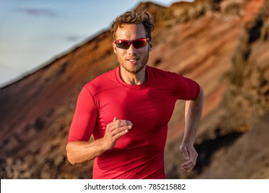 Athlete runner trail running in mountains nature. Sport active fitness ultra trail, run marathoner training outdoor in summer outdoors. Man with sunglasses.