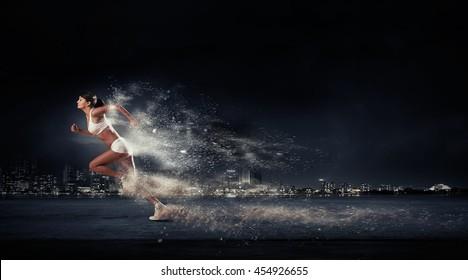 Athlete running fast . Mixed media