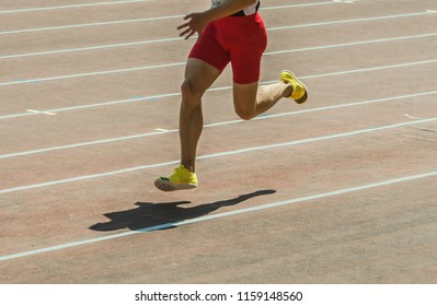 The athlete runs on the racetrack of stadium