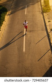 Athlete runs on the road.