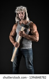 Athlete with sexy torso with sledge hammer. man worker with fit torso. male hold sledge hammer. power and energy concept. bodybuilding. man worker in winter hat. opportunity concept. mens power.