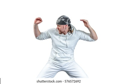Athlete shows capoeira techniques with dark bandana on his head, isolated