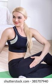 Athlete shows her body in sportswear. Concept: healthy lifestyle, fitness, pilates, aerobics, shaping, beautiful body.
