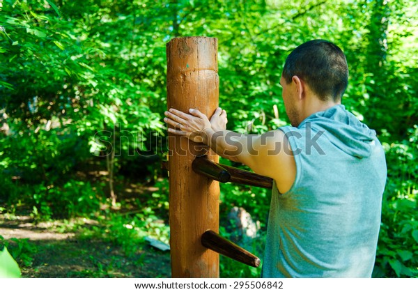 Athlete Shows Techniques Wingchun Kungfu Wooden Stock Photo
