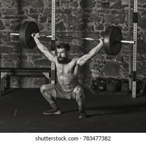 Athlete snatching a heavy barbell