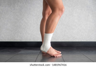 Athlete with a sprained ankle struggling to weight bear