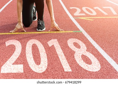 Athlete Starting line waiting start running track with text 2018 year, Start to new year next future