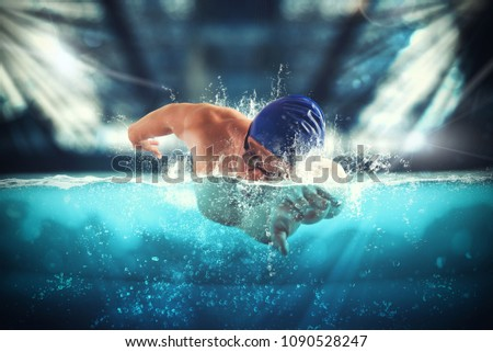 Athlete swims in a blue deep pool