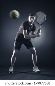 athlete with a tennis racket in anticipation of the ball.