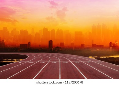 Athlete Track or Running Track with nice back view of the shadow in the city and sunset scenic