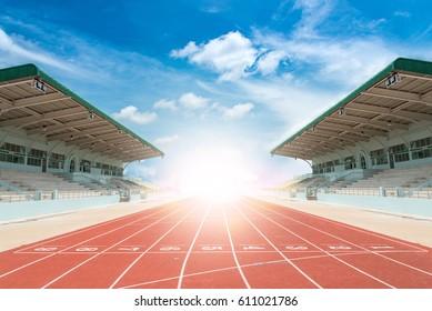 Athlete track running track and stadium with sky sunrise background