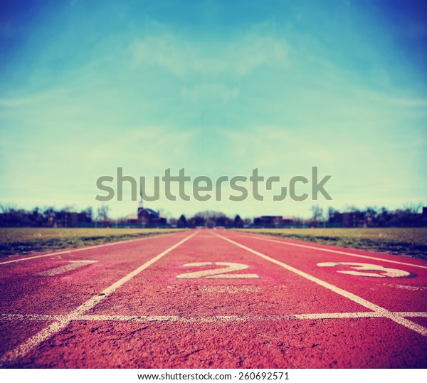 Athlete Track or Running Track with three numbers (1st, 2nd and 3rd) good for business or motivation designs toned with a retro vintage instagram filter app or action effect
