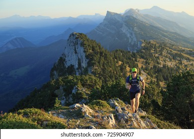 Athlete trailrunning in the mountains on a beautiful afternoon. Vercors, France.
