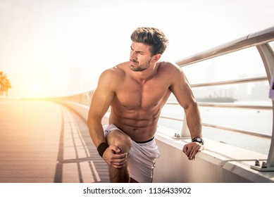 Athlete training outdoors - Handsome sportive man doing workout on the streets