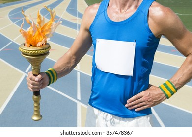 Athlete wearing blank race bib holding sport torch in front of running track