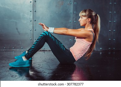 Athlete woman doing abdominal crunches exercise Side view concept fitness sport training