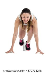 Athlete woman in ready to run position on white background