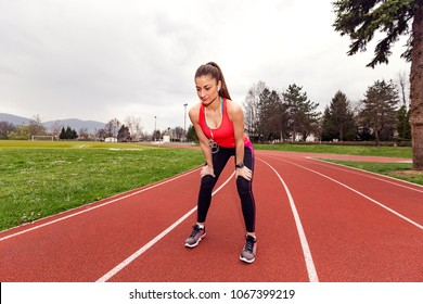 Athlete woman resting after running workout outside