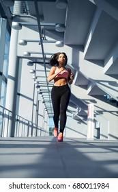 Athlete woman running building