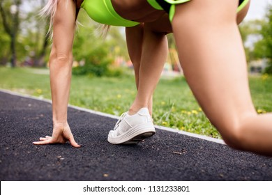 Athlete Woman In Running Start Pose Outdoors The Summer Sport Concept