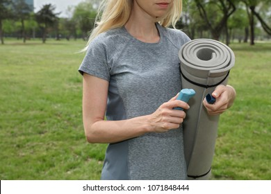 Athlete woman using asthma inhaler outdoors. Allergic Asthma Symptoms, Treatment. Sports and allergy.