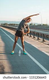Athlete women stretching before exercising