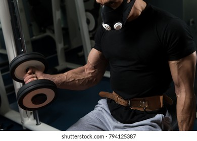 Athlete Working Out Biceps In Elevation Mask - Dumbbell Concentration Curls