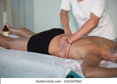 Athletes Back Professional Massage after Fitness Activity -Wellness and Sport