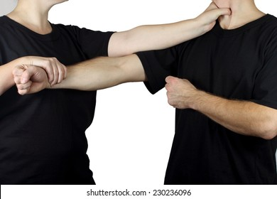 Athletes in black t-shirts on white background are training Wing Chun Kung Fu techniques