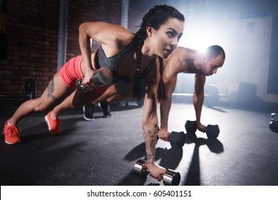 Athletes lifting weights and doing push ups