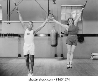 Athletes on rings in gym