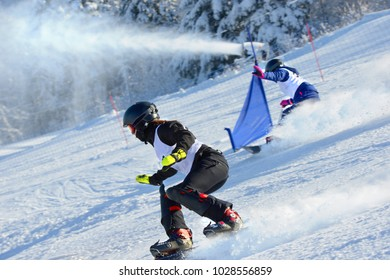 Athletes on a snowboarding slalom