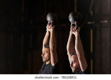Athletes practicing kettlebell drills