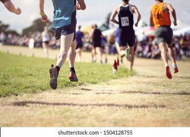 Athletes race in a track marathon running competition