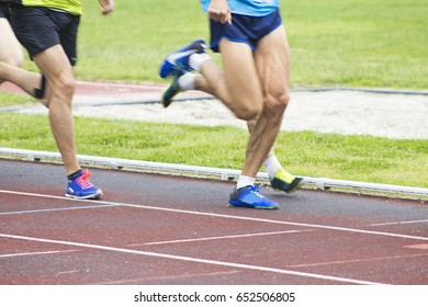 athletes running on the athletics track