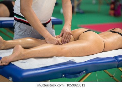 Athlete's Thigh Muscle Professional Massage Treatment after Sport Workout Fitness and Wellness.