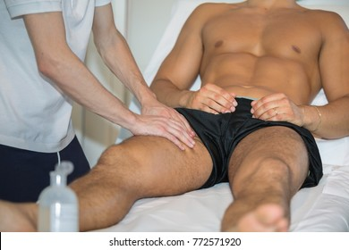 Athlete's Thigh Muscle Professional Massage Treatment after Sport Workout- Fitness and Wellness.