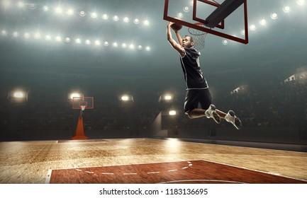 Athletic african american basketball player scoring a layup basket