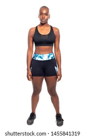 Athletic African American black female wearing workout clothing.  Her sporty outfit is a sports bra and form fitting spandex shorts.  She looks strong and confident.